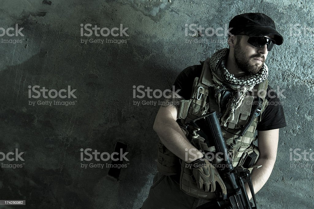 Night Portrait of Modern Mercenary Soldier Looking Worried royalty-free stock photo