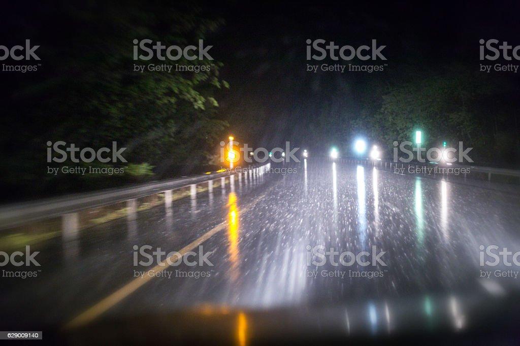 Night Road Marker Lens Flare Reflectors Through Speeding Car Windshield stock photo