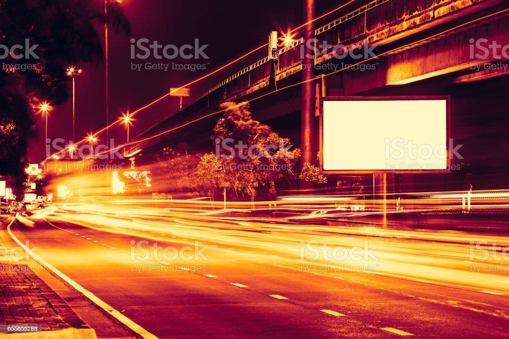night road street light with high speed car trail light. stock photo