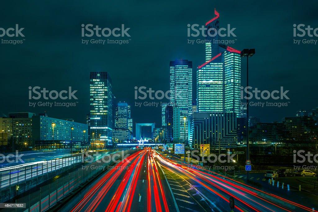 Night road with skyscrapers of La Defense, Paris, France stock photo