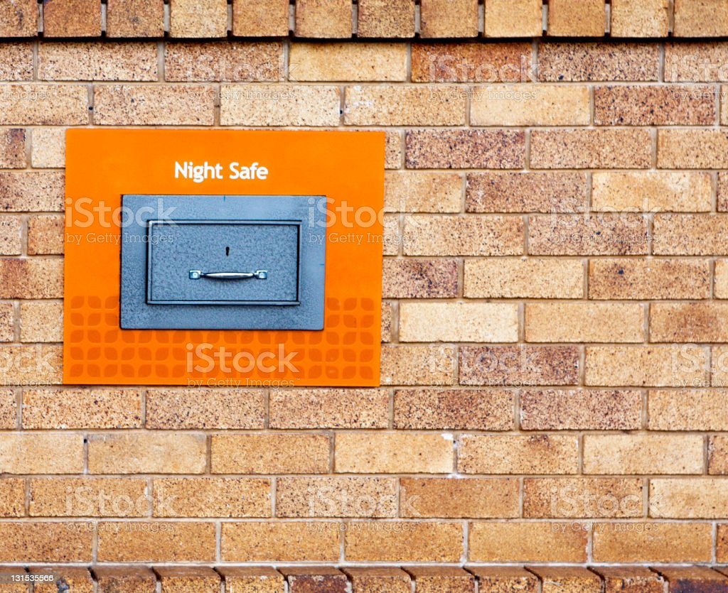 Night Safe in a brick wall stock photo