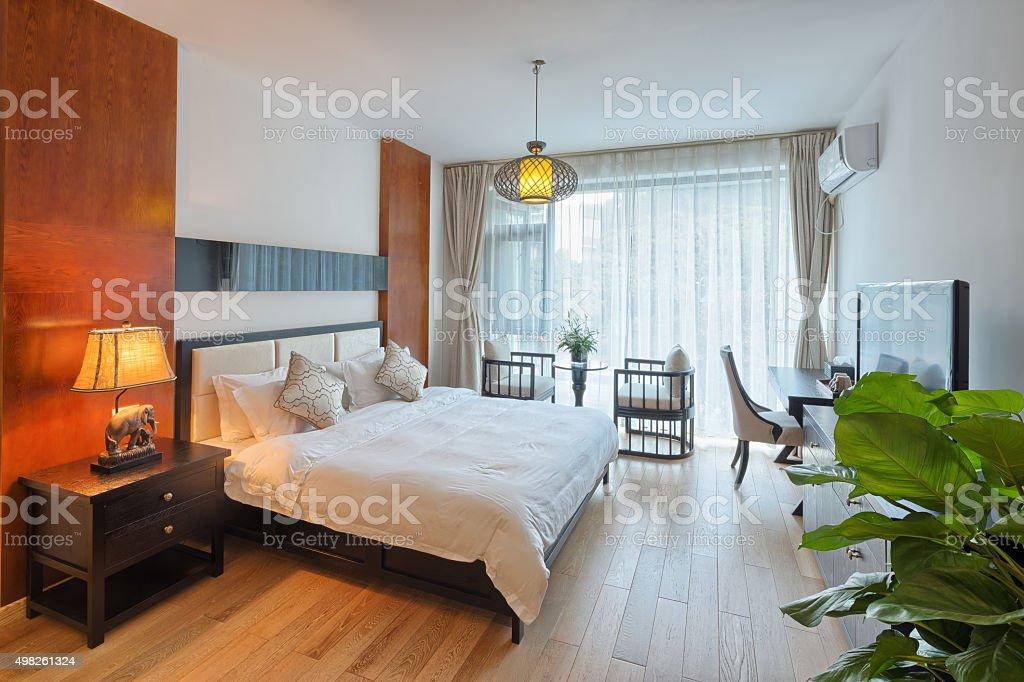 Night scene in hotel room: prepared fresh bed stock photo