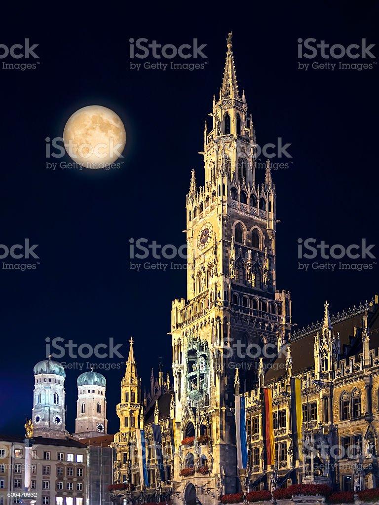 Night scene Munich Town Hall and moon stock photo