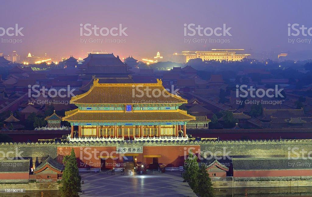 Night scene of Forbidden City in the fog stock photo
