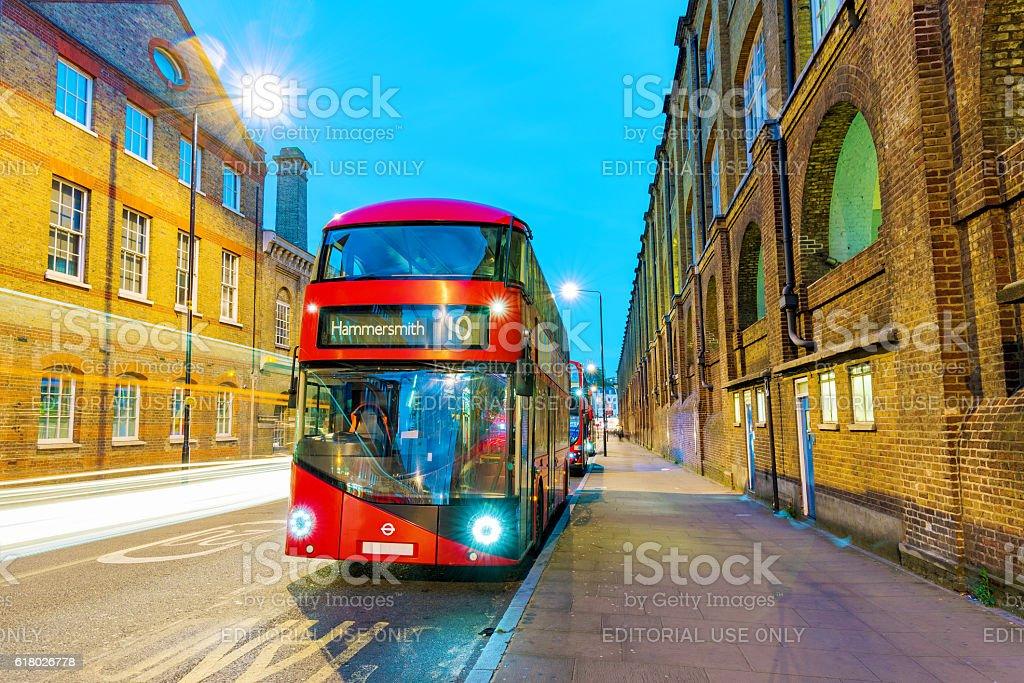 Night scene of London bus stock photo