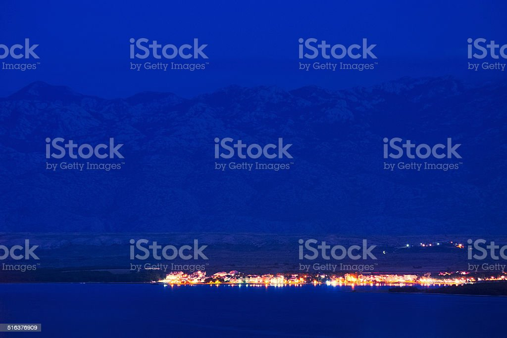 Night scene of small town between sea and mountains stock photo