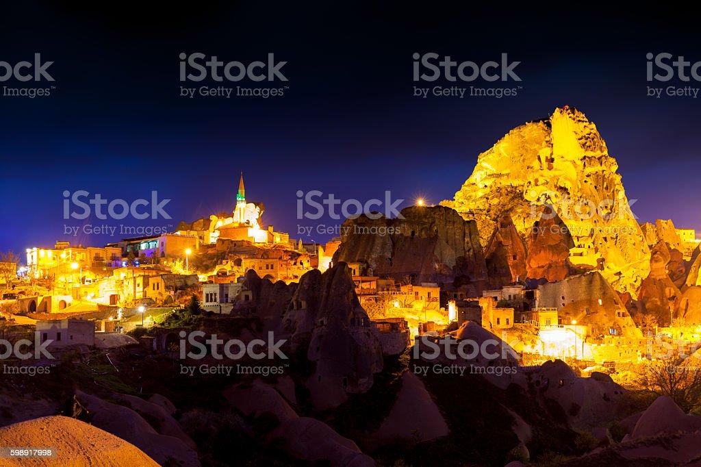Night scene of the Uchisar Castle in Cappadocia. Illuminated vie stock photo