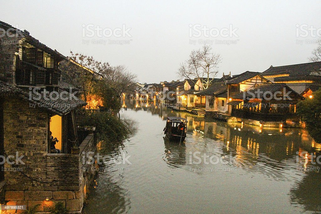 Night scene of traditional building near the river stock photo