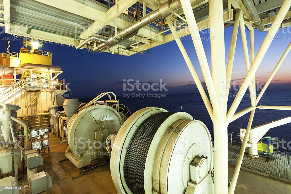 night scene of yellow sea from oil drill platform's windlass stock photo