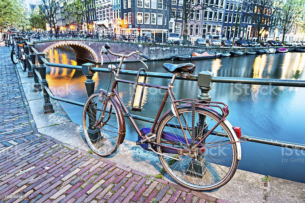 Night Scene with Bicycle and Water Canal in Amsterdam stock photo