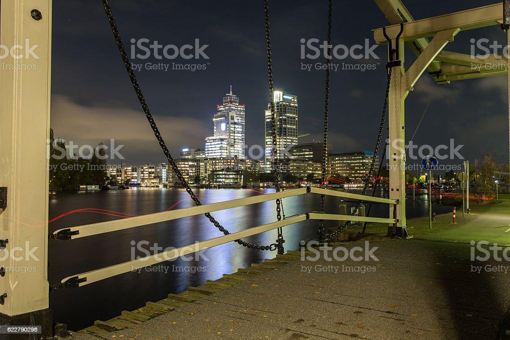 Night scene with drawbridge at Amstel river, Amsterdam city center stock photo