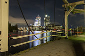 Night scene with drawbridge at Amstel river, Amsterdam city center