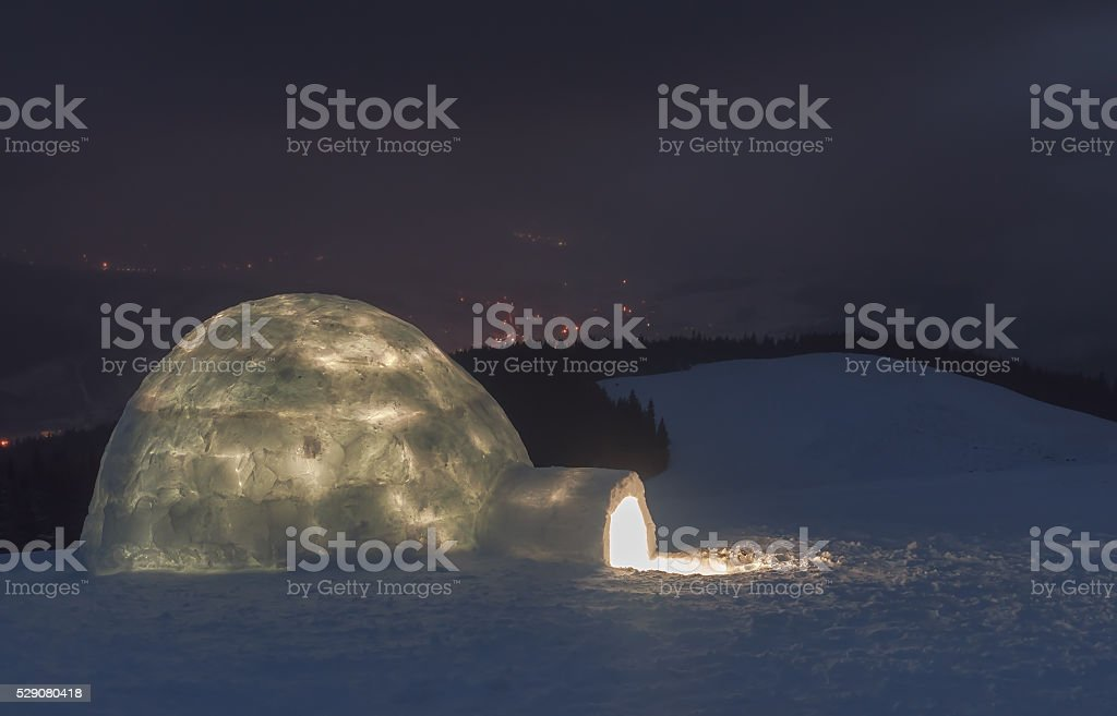 night scene with igloo stock photo