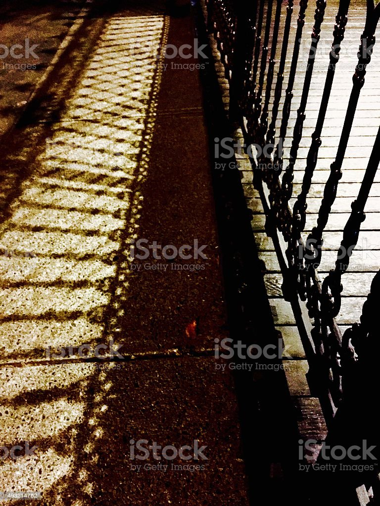 Night shadows of a fence at night royalty-free stock photo