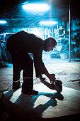 Night shift Worker Cutting Fiberglass plate