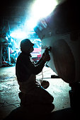 Night shift Worker Sanding Fiberglass