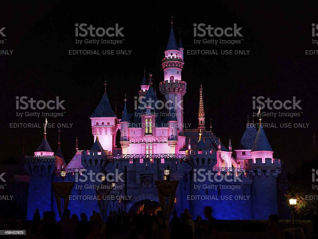 Night shot of Disney's Sleeping Beauty Castle in Fantasyland stock photo