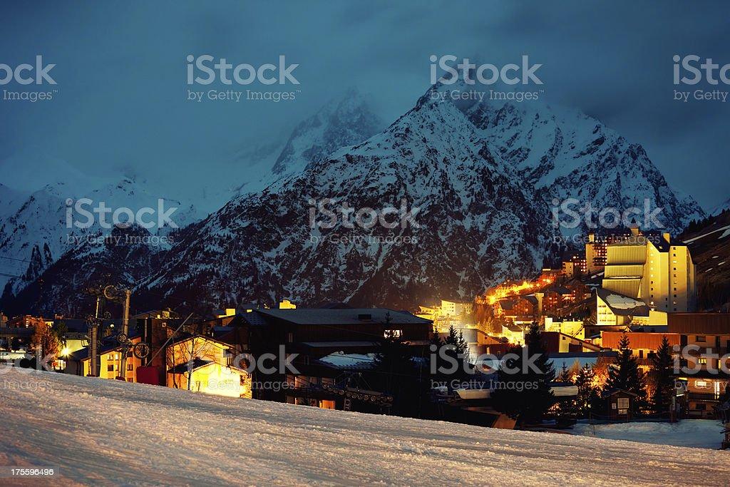 Night shot of France ski resort Les 2 Alpes stock photo