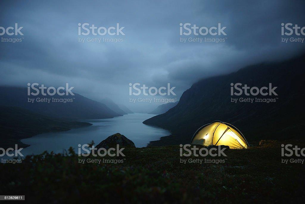 night shot of illuminated tent in the Jotunheimen national park stock photo