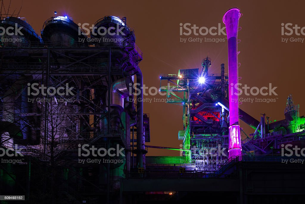 Night shot of Landschaftspark Nord, old illuminated industrial ruins in stock photo