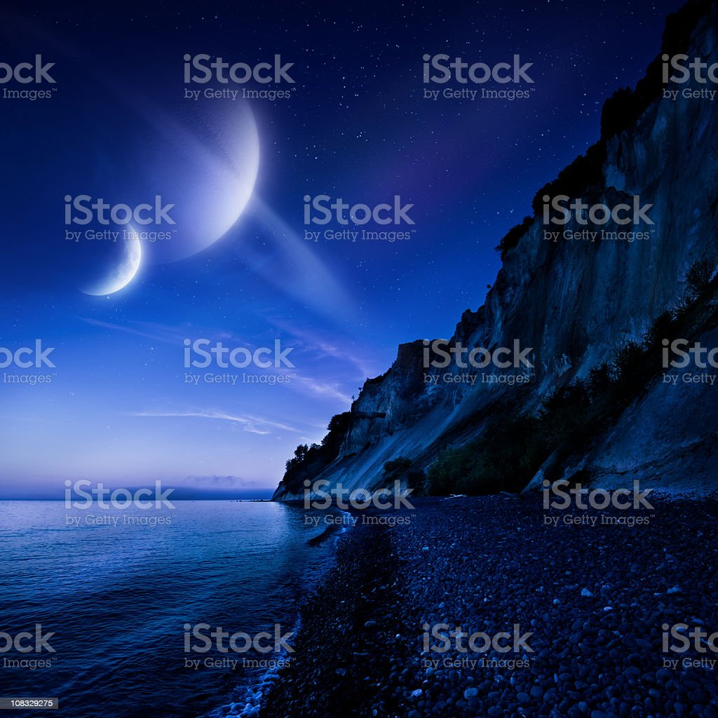 Night shot of mountains and sea royalty-free stock photo