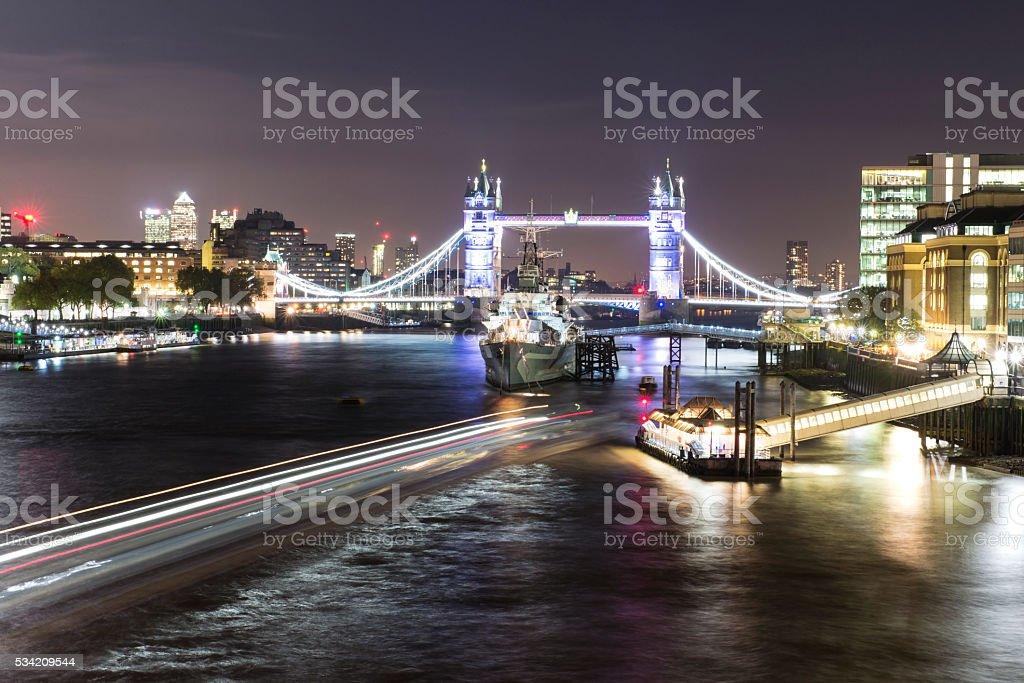 Night shot of Tower Bridge and HMS Belfast stock photo