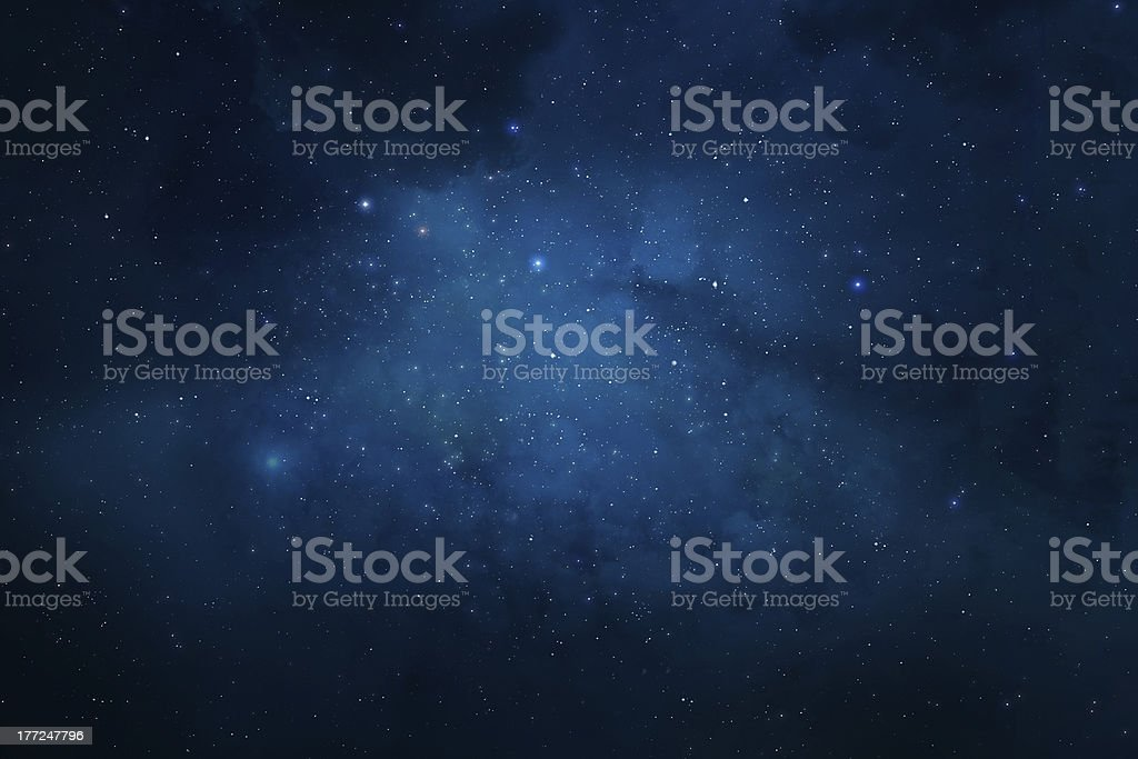 Night sky filled with stars and nebulae stock photo