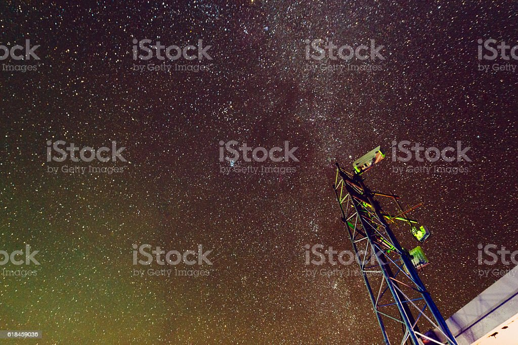 Night Sky Space with Communications Technology Haleakala National Park Maui stock photo