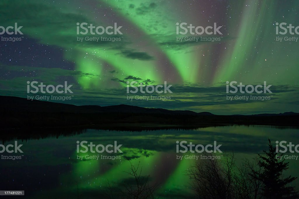 Night Sky Stars Clouds Northern Lights mirrored stock photo
