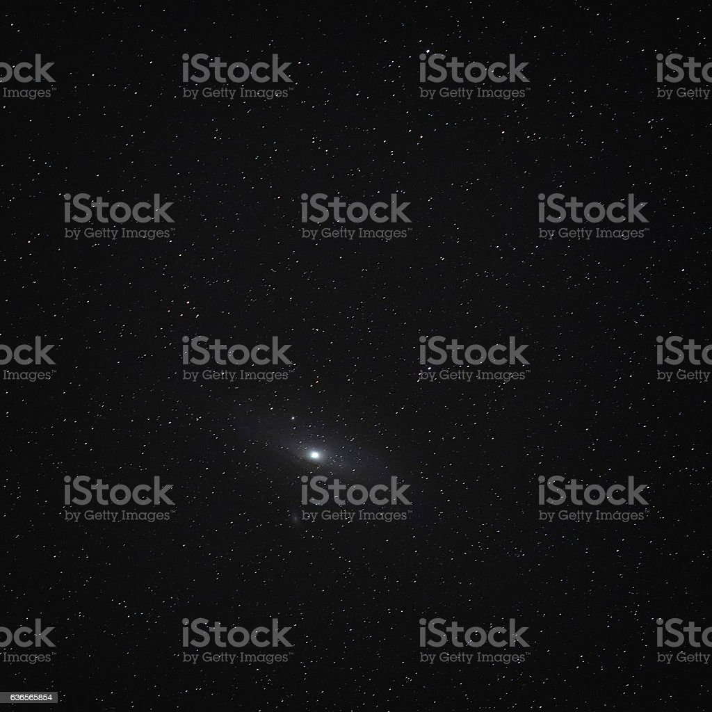 Night sky with stars and a spiral galaxy Andromeda. stock photo