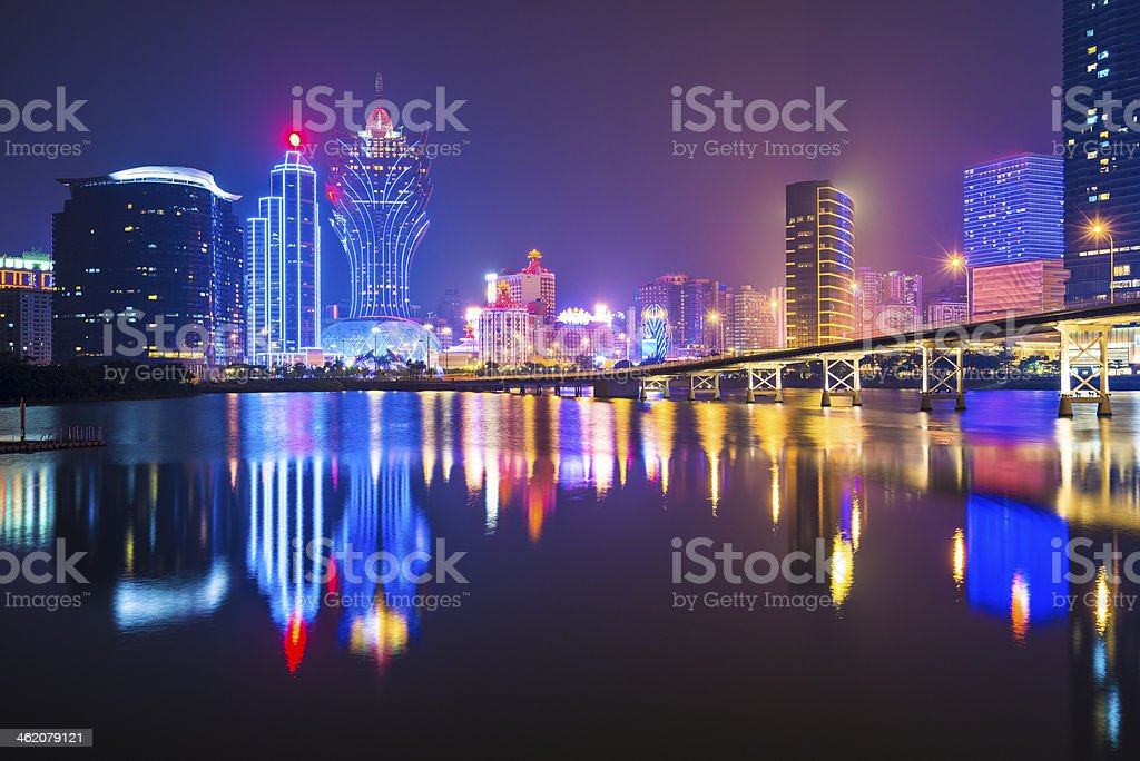 Night skyline of Macau viewed from the water stock photo