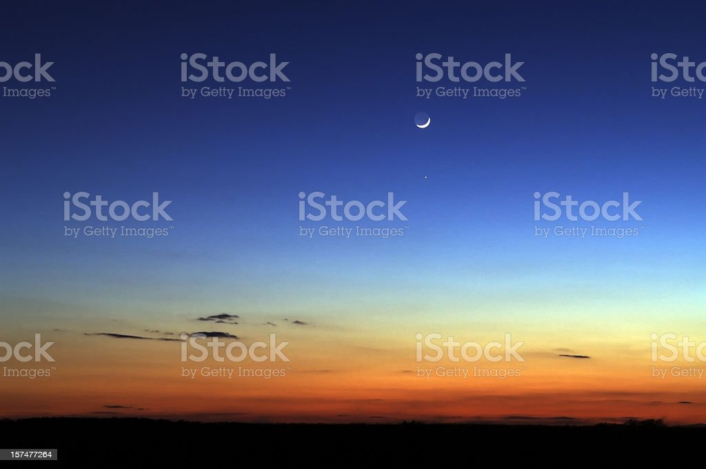 Night skyline with moon in the distance stock photo