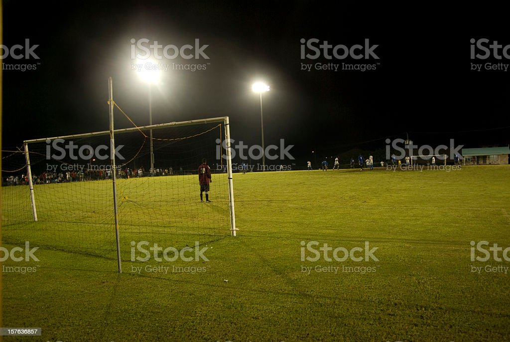 night soccer game with goal and goalkeeper royalty-free stock photo