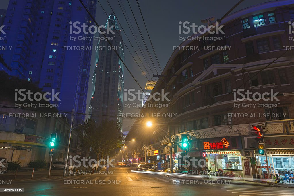 Night street lights store fronts apartment blocks Shanghai China royalty-free stock photo