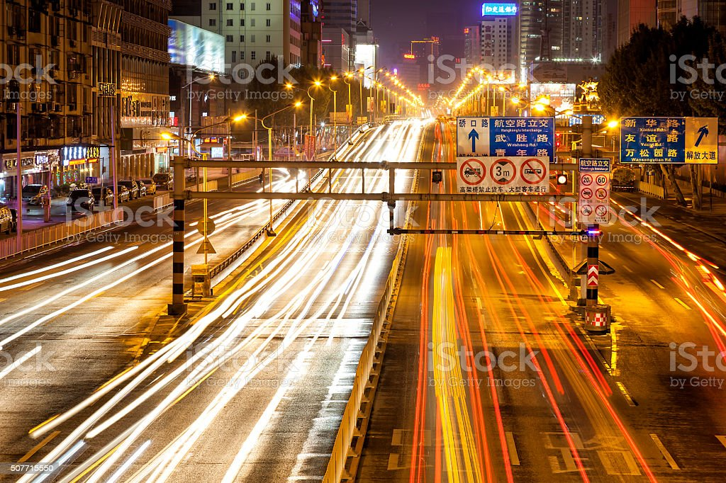 Night Street Scene with Car Light Trails in Wuhan, China stock photo