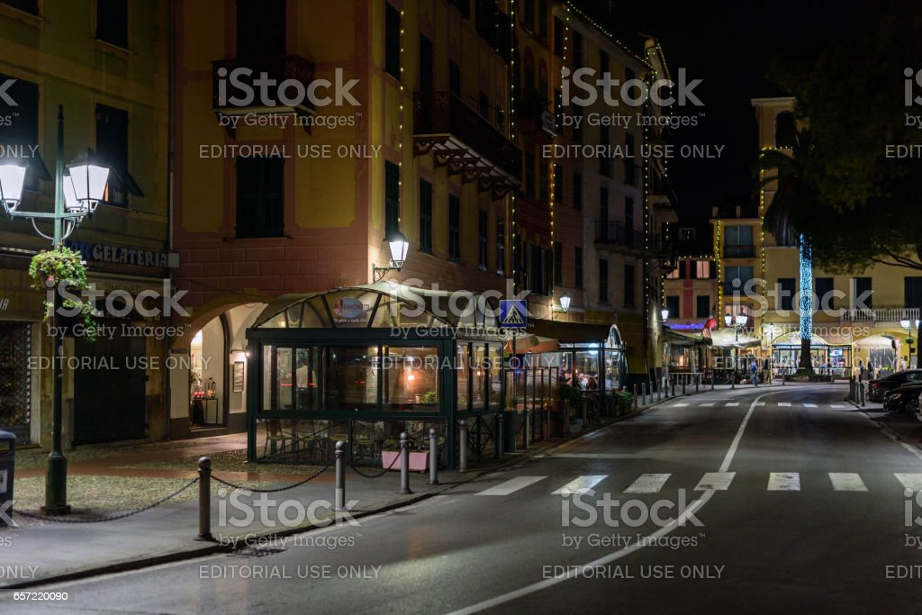 Night street with restaurants at Santa Margherita town, Italy