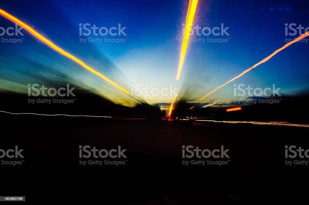 Night time highway blurred stream of light stock photo