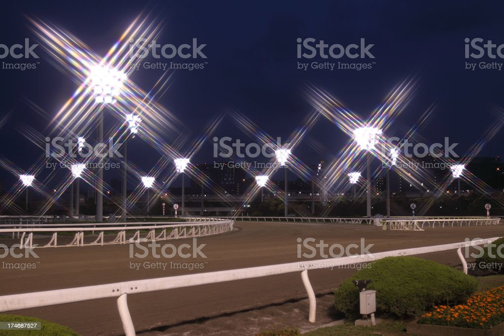 Night time horse track on a clear night stock photo