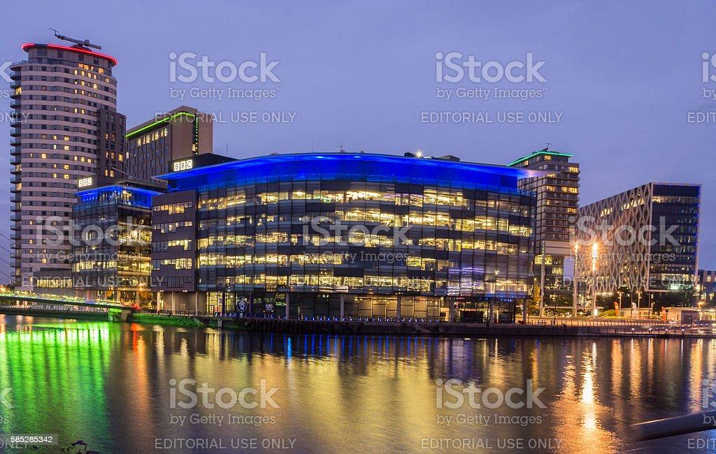 Night time illumination of Media city reflected stock photo