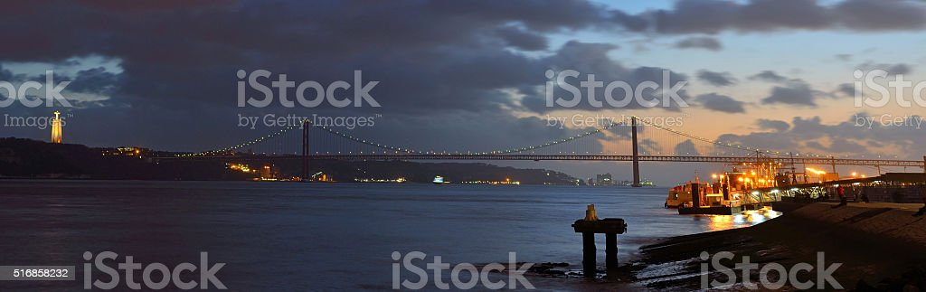 Night time panorama of the river Tagus stock photo