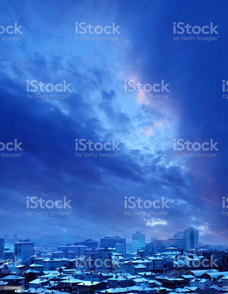 night time snow covered city stock photo