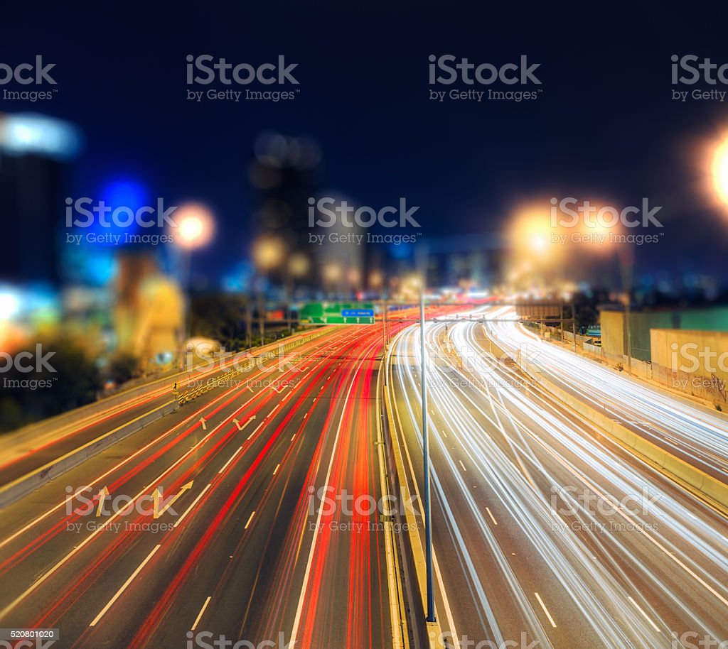 Night traffic travelling into the city stock photo
