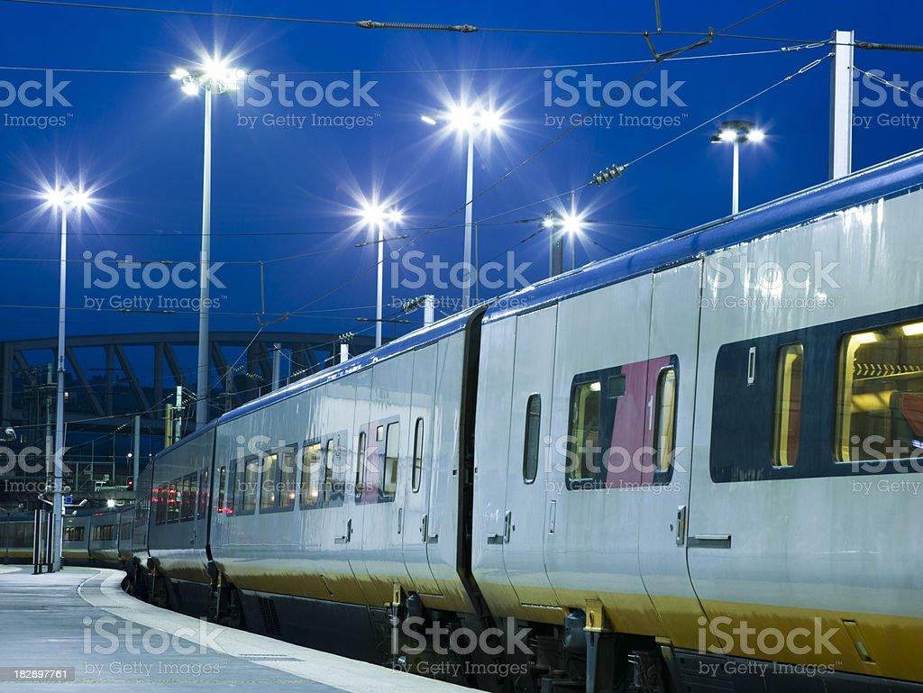 Night Train at Illuminated Station royalty-free stock photo
