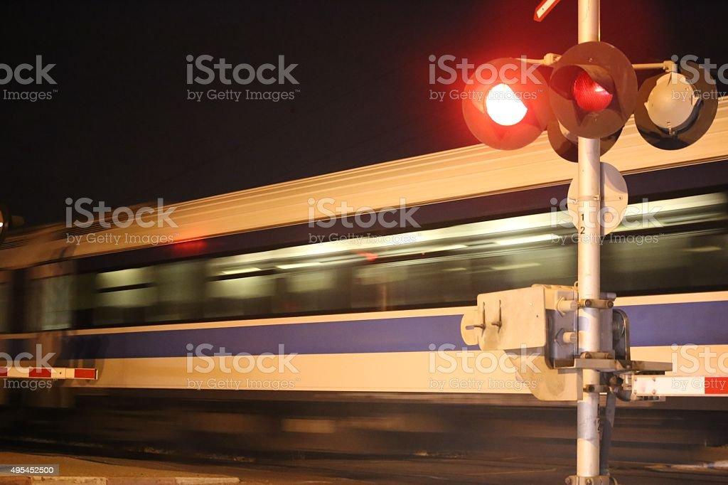 Night Train Passes Railway Crossing stock photo