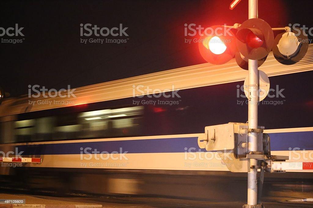 Night Train speeds in Railway Crossing stock photo