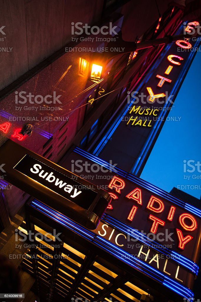 Night upward view of Radio City Music Hall neon sign stock photo