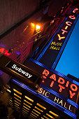 Night upward view of Radio City Music Hall neon sign