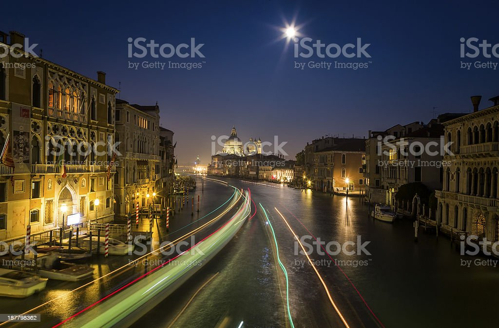 Night View in Venice with Blurred Motion of Boats stock photo