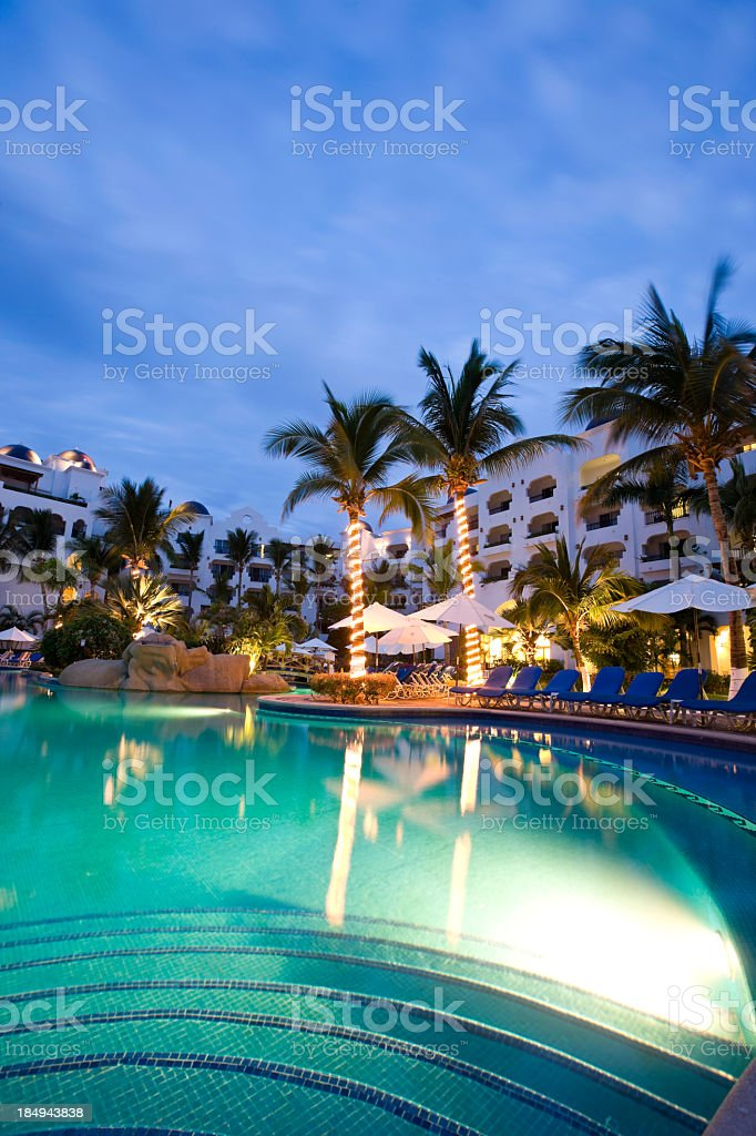 Night view of a pool & resort in Cabo San Lucas, Mexico stock photo
