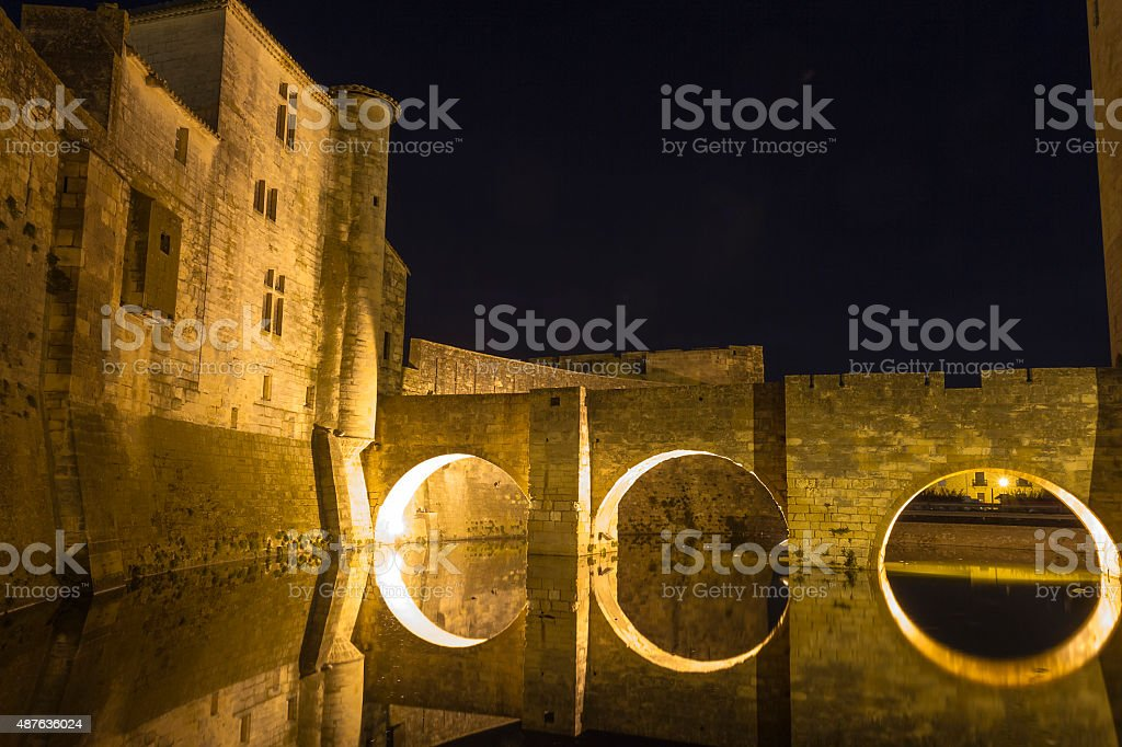 Night view of ancient walls of Aigues-Mortes - Camargue stock photo